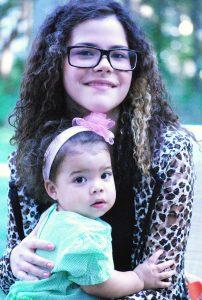 Image of Angela Kulewicz and a baby.